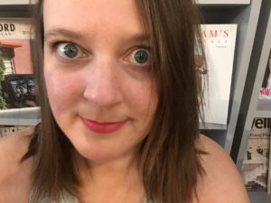 Selfie of Andrea Klunder with wide eyes inside a local bookstore